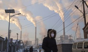 Smoke billows from a coal fired power plant in Shanxi, China.